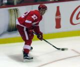 Matt Lorito carries the puck along the boards during a preseason game.