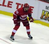 Riley Sheahan skates in the corner during a preseason game.