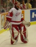 Curtis Joseph stands behind the net during pregame warmups.