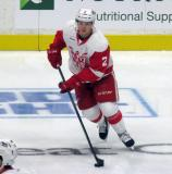 Joe Hicketts carries the puck during pre-game warmups before a Grand Rapids Griffins game.