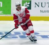Robbie Russo skates in the neutral zone during pre-game warmups before a Grand Rapids Griffins game.