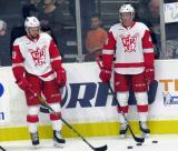 Dylan Sadowy and Conor Allen stand at the boards during pre-game warmups before a Grand Rapids Griffins game.
