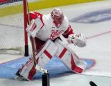 Jared Coreau lifts his blocker to stop a shot during pre-game warmups before a Grand Rapids Griffins game.