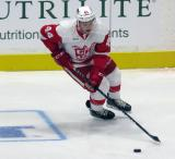 Conor Allen skates with the puck during pre-game warmups before a Grand Rapids Griffins game.