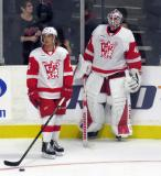 Mitch Callahan and Eddie Pasquale stand near the boards during pre-game warmups before a Grand Rapids Griffins game.