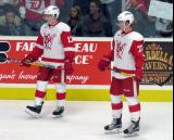 Matt Caito and Evgeny Svechnikov stand near the boards during pre-game warmups before a Grand Rapids Griffins game.