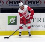 Robbie Russo looks to make a pass during pre-game warmups before a Grand Rapids Griffins game.