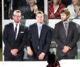 Daniel Cleary, Mike Borkowski, and Matthew Ford stand at the bench after being introduced as scratches during player introductions at the Grand Rapids Griffins' home opener.