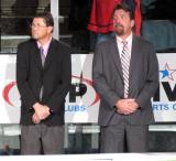Video coach Bill Leroy and assistant coach Bruce Ramsay stand at the bench during player introductions at the Grand Rapids Griffins' home opener.