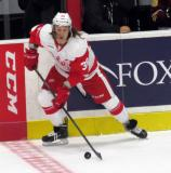 Tyler Betuzzi carries the puck along the boards during a Grand Rapids Griffins game.