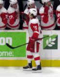 Mitch Callahan skates along the bench giving fist-bumps in celebration of a goal during a Grand Rapids Griffins game..