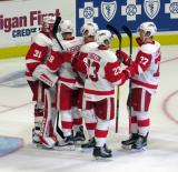 Jared Coreau, Brian Lashoff, Conor Allen, Dominic Turgeon, and Evgeny Svechnikov celebrate a Grand Rapids Griffins win.