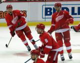 Mike Green and Ryan Sproul skate through the neutral zone during pre-game warmups, with Justin Abdelkader in front of them.