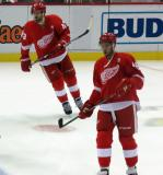 Darren Helm and Ryan Sproul skate in the neutral zone during pre-game warmups.