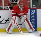 Petr Mrazek crouches at the boards during pre-game warmups.