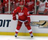 Tomas Tatar stands at the boards during pre-game warmups.
