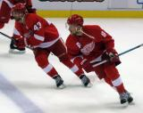 Darren Helm and Justin Abdelkader skate across the blue line during pre-game warmups.