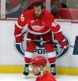 Henrik Zetterberg crouches at the boards during pre-game warmups.
