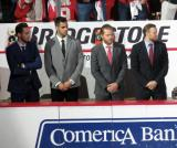 Tomas Jurco, Ryan Sproul, Steve Ott, and Niklas Kronwall stand on the bench after being introduced as scratches during player introductions at the Red Wings' home opener.