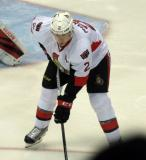 Dion Phaneuf of the Ottawa Senators gets set for a faceoff during a game against the Detroit Red Wings.