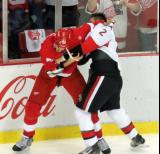 Jonathan Ericsson fights with Dion Phaneuf of the Ottawa Senators.