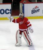 Petr Mrazek raises his stick to the fans as one of the three stars of the game.
