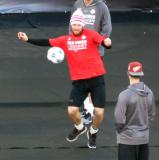 Nick Jensen plays soccer at field-level before the Centennial Classic.