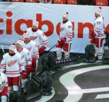 Riley Sheahan, Luke Glendening, Xavier Ouellet, Drew Miller, Henrik Zetterberg, and Niklas Kronwall walk to the ice for pre-game warmups before the Centennial Classic.