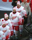 Xavier Ouellet, Drew Miller, Henrik Zetterberg, and Niklas Kronwall walk to the ice for pre-game warmups before the Centennial Classic.
