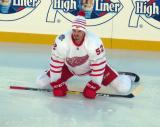 Jonathan Ericsson stretches on the ice during pre-game warmups before the Centennial Classic.