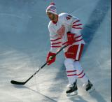 Ryan Sproul skates across the blue line during pre-game warmups before the Centennial Classic.
