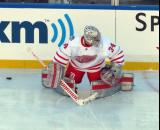 Petr Mrazek stretches near the boards during pre-game warmups before the Centennial Classic.