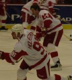 Brendan Shanahan skates along the edge of the far circle as Tomas Holmstrom first a shot on goal during pregame warmups.