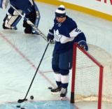 Matt Martin of the Toronto Maple Leafs stands next to the net during pre-game warmups before the Centennial Classic.