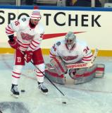 Tomas Jurco carries the puck next to Petr Mrazek during pre-game warmups before the Centennial Classic.
