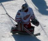 Petr Mrazek stretches during pre-game warmups before the Centennial Classic.