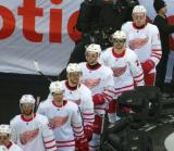 Frans Nielsen, Dylan Larkin, Brendan Smith, Nick Jensen, Tomas Tatar, and Anthony Mantha walk to the ice at the start of the Centennial Classic.