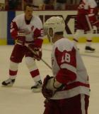 Kirk Maltby watches as Nicklas Lidstrom skates through the slot during pregame warmups.