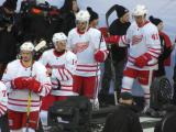 Jonathan Ericsson, Gustav Nyquist, Riley Sheahan, and Luke Glendening walk to the ice at the start of the Centennial Classic.