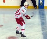 Danny DeKeyser skates near the blue line during the Centennial Classic.