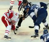 Andreas Athanasiou takes a faceoff against Frederik Gauthier of the Toronto Maple Leafs during the Centennial Classic.