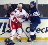 Niklas Kronwall and Toronto's Nikita Soshnikov come together along the boards during the Centennial Classic.