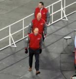 Red Wings coaches Jeff Blashill, Pat Ferschweiler, and John Torchetti walk to the Detroit bench at the start of the second period of the Centennial Classic.