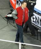 Red Wings assistant coach John Torchetti walks to the Detroit bench at the start of the second period of the Centennial Classic.