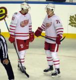 Xavier Ouellet and Dylan Larkin talk during a stop in play in the Centennial Classic.