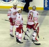Drew Miller, Brendan Smith, and Jared Coreau wait for the handshake line at the end of the Centennial Classic.