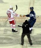 Henrik Zetterberg meets Tyler Bozak of the Toronto Maple Leafs at center ice to start the handshake line at the end of the Centennial Classic.