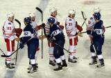 Danny DeKeyser, Xavier Ouellet, Anthony Mantha, Drew Miller, and Niklas Kronwall shake hands with Tyler Bozak, Leo Komarov, and William Nylander of the Toronto Maple Leafs at the end of the Centennial Classic.