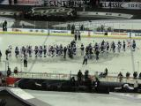 The Red Wings and Maple Leafs meet for a handshake line at the end of the Centennial Classic.