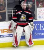 Eddie Pasquale stands at the boards during pre-game warmups before a Grand Rapids Griffins game.